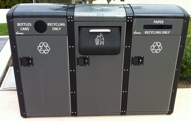 Solar powered waste recycling center in public park cropped